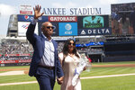 Former New York Yankees pitcher and hall of famer Mariano Rivera waves as the crowd as he leaves the field with his wife Clara during a ceremony before a baseball game between the New York Yankees and the Cleveland Indians, Saturday, Aug. 17, 2019, in New York. (AP Photo/Mary Altaffer)
