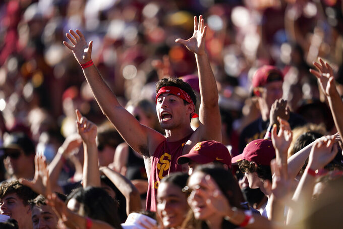 Southern California fans cheer during the second half of an NCAA college football game against San Jose State Saturday, Sept. 4, 2021, in Los Angeles. (AP Photo/Ashley Landis)