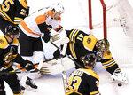 Boston Bruins goaltender Jaroslav Halak (41) covers the puck under pressure from Philadelphia Flyers left wing James van Riemsdyk (25) during first-period NHL hockey playoff action in Toronto, Sunday, Aug. 2, 2020. (Frank Gunn/The Canadian Press via AP))
