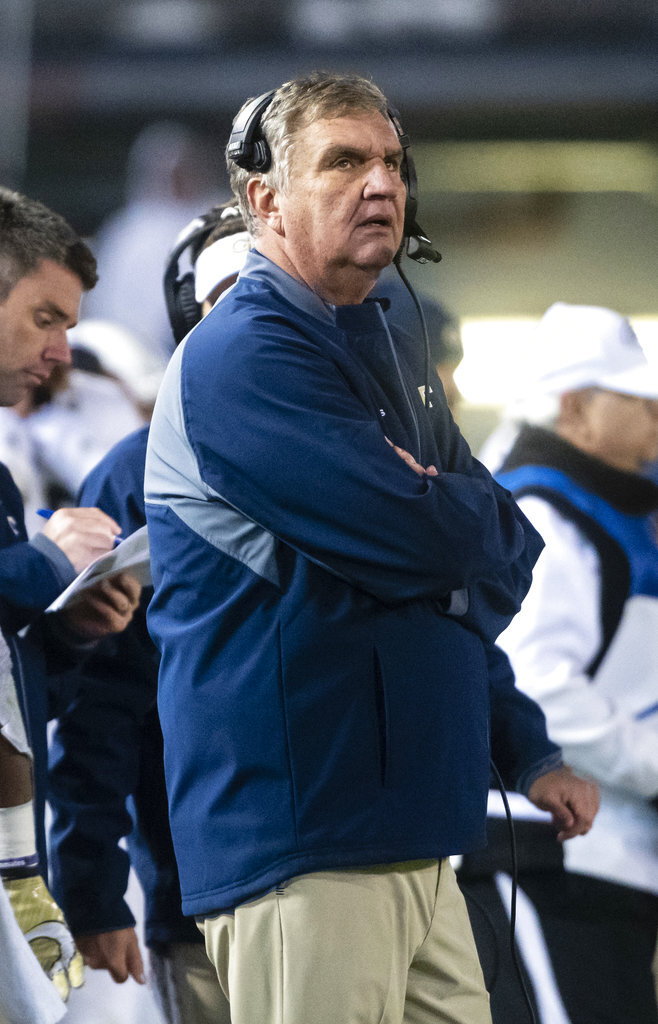 Georgia Tech coach Paul Johnson looks at the scoreboard during the fourth quarter of the team's NCAA college football game against Miami, Saturday, Nov. 10, 2018, in Atlanta. Georgia Tech won 27-21. (AP Photo/John Amis)