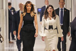 New York Stock Exchange President Stacey Cunningham, right, and first lady Melania Trump tour the New York Stock Exchange in New York, Monday, Sept. 23, 2019. (AP Photo/Seth Wenig)