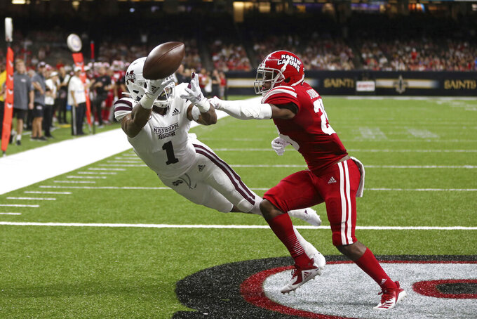 Louisiana-Lafayette safety Jaden Henderson (29) breaks up a potential touchdown catch by Mississippi State wide receiver Stephen Guidry (1) in the second quarter of an NCAA college football game in New Orleans, Saturday, Aug. 31, 2019. (AP Photo/Chuck Cook)