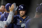 Tampa Bay Rays' Nate Lowe is greeted in the dugout by teammates after hitting a two-run home run off Baltimore Orioles starting pitcher John Means during the sixth inning of the second baseball game of a doubleheader Saturday, July 13, 2019, in Baltimore. The Rays won 12-4. (AP Photo/Julio Cortez)