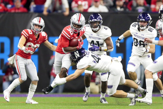 Ohio State running back Demario McCall (30) is tackled by Northwestern defensive back Joe Bergin during the second half of the Big Ten championship NCAA college football game, Saturday, Dec. 1, 2018, in Indianapolis. (AP Photo/AJ Mast)
