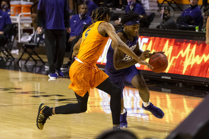 Texas Christian guard RJ Nembhard (22) drives past Oklahoma State guard Rondel Walker (5)during the first half of the NCAA college basketball game against in Stillwater, Okla., Wednesday, Dec. 16, 2020. (AP Photo/Mitch Alcala)
