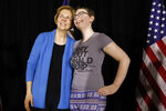 Sen. Elizabeth Warren, D-Mass., poses for a photo with a local resident during an organizing event, Sunday, Feb. 10, 2019, in Cedar Rapids, Iowa.(AP Photo/Charlie Neibergall)