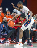 Nebraska guard Thomas Allen (12) drives into Illinois guard Aaron Jordan (23) during the second half of an NCAA college basketball game in Champaign, Ill., Saturday. Feb. 2, 2019. (AP Photo/Robin Scholz)
