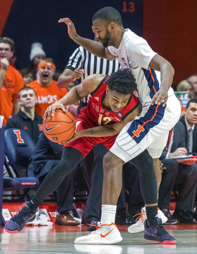 Nebraska guard Thomas Allen (12) drives into Illinois guard Aaron Jordan (23) during the second half of an NCAA college basketball game in Champaign, Ill., Saturday. Feb. 2, 2019. (AP Photo/Robin Scholz)