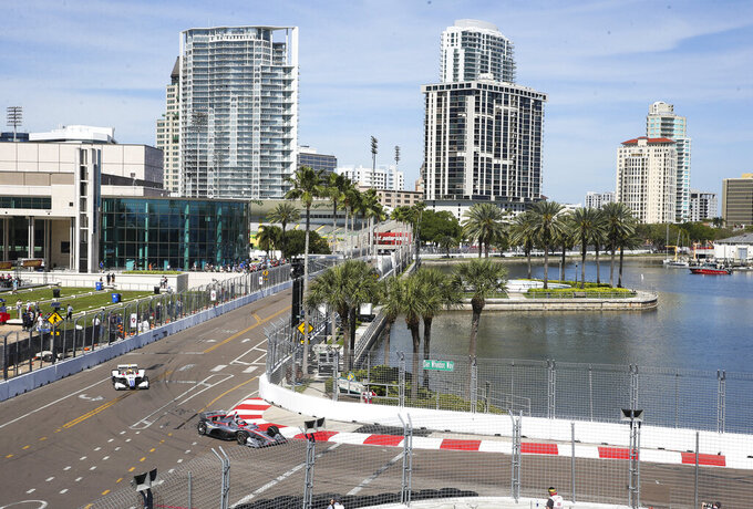 Cars round Turn 10 during a practice session at the Grand Prix of St. Petersburg auto race in St. Petersburg, Fla., Friday, March 8, 2019. (Dirk Shadd/Tampa Bay Times via AP)