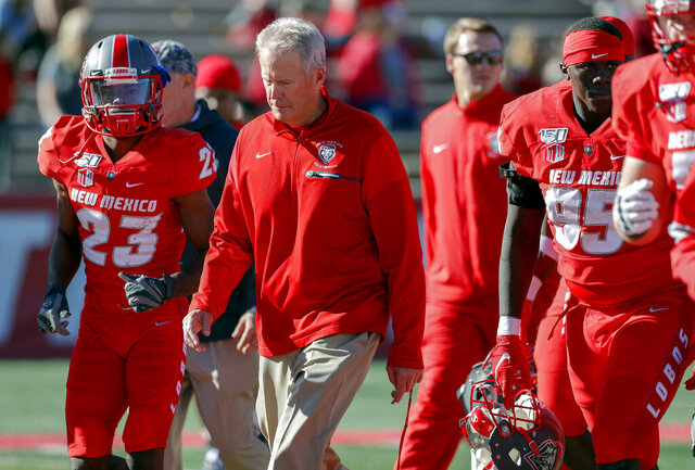 FILE - In this Saturday, Oct. 26, 2019, file photo, New Mexico coach Bob Davie leads his team from the field at halftime of an NCAA college football game against Hawaii in Albuquerque, N.M. On Monday, Nov. 25, Davie agreed to step aside as New Mexico's coach at the end of the season, ending an uneven eight-season tenure with the Lobos. (AP Photo/Andres Leighton, File)