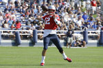 New England Patriots quarterback Tom Brady winds up for a pass during practice at NFL football training camp, Sunday, July 28, 2019, in Foxborough, Mass. (AP Photo/Steven Senne)