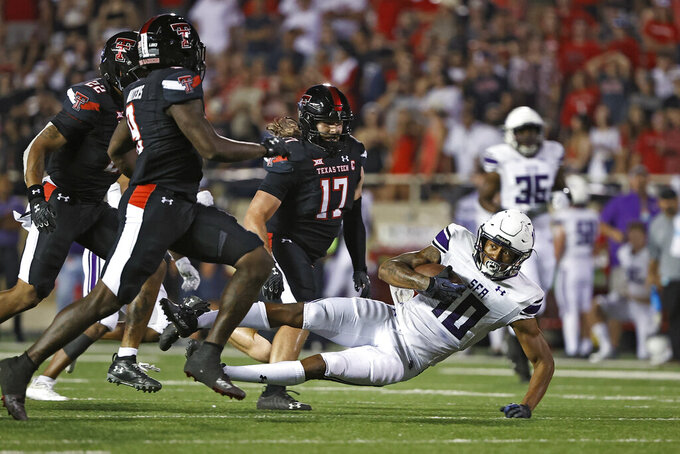 Stephen F. Austin's Darryle Simmons (10) falls to the ground during the second half of the team's NCAA college football game against Texas Tech, Saturday, Sept. 11, 2021, in Lubbock, Texas. (AP Photo/Brad Tollefson)