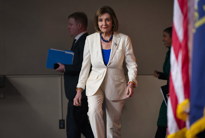 Speaker of the House Nancy Pelosi, D-Calif., arrives to talk to reporters as the House Intelligence Committee holds public impeachment hearings of President Donald Trump's efforts to tie U.S. aid for Ukraine to investigations of his political opponents. Pelosi says there is clear evidence that President Donald Trump has used his office for his personal gain. She says doing that