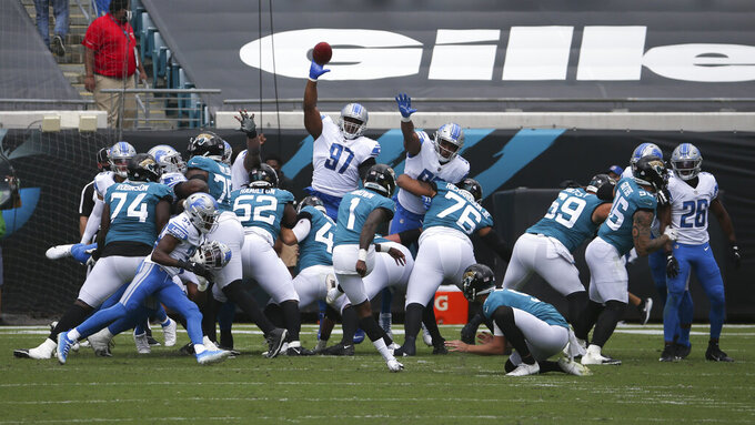 Jacksonville Jaguars place kicker Jon Brown (1) kicks a field goal against the Detroit Lions during the first half of an NFL football game, Sunday, Oct. 18, 2020, in Jacksonville, Fla. (AP Photo/Stephen B. Morton)