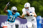 Indianapolis Colts tight end Jack Doyle makes a catch in front of Carolina Panthers safety Juston Burris during a joint practice at the NFL team's football training camp in Westfield, Ind., Thursday, Aug. 12, 2021. (AP Photo/Michael Conroy)