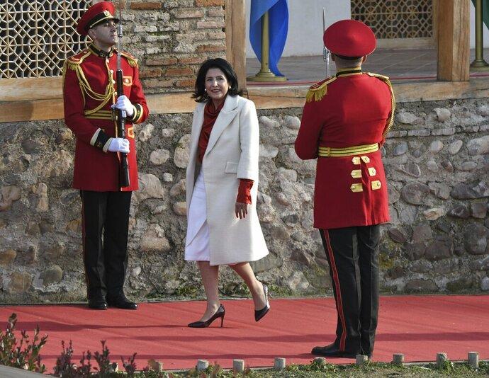 FILE In this file photo taken on Sunday, Dec. 16, 2018, Georgian President Salome Zurabishvili arrives to attend her inauguration in Telavi, Georgia. Georgia's president says she'll