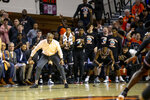 Oklahoma State head coach Mike Boynton Jr. yells as his team cheers in the background  during an NCAA college basketball game against Oklahoma State in Stillwater, Okla., Saturday, Feb. 15, 2020. (AP Photo/Mitch Alcala)