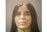 """FILE - This photo provided by the Alexandria Adult Detention Center shows Emma Coronel Aispuro. The wife of Mexican drug kingpin Joaquin """"El Chapo"""" Guzman is expected to plead guilty to federal criminal charges after she had been charged in the U.S. with helping her husband run his multibillion-dollar criminal empire. Emma Coronel Aispuro is due in court Thursday, June 10, 2021, in Washington for a plea agreement hearing, according to court records. (Alexandria Adult Detention Center via AP)"""