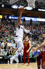 Dallas Mavericks guard Jalen Brunson (13) make a layup against the Cleveland Cavaliers during the first half of an NBA basketball game in Dallas, Saturday, March 16, 2019. (AP Photo/Michael Ainsworth)