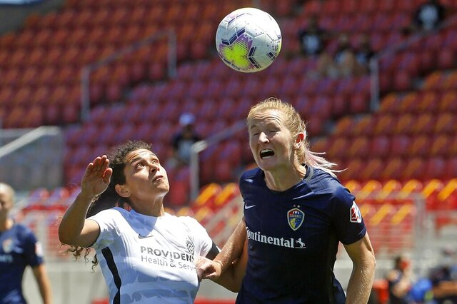 Portland Thorns FC midfielder Rocky Rodriguez, left, and North Carolina Courage midfielder Samantha Mewis, right, battle for the ball during the second half of an NWSL Challenge Cup soccer match at Zions Bank Stadium Saturday, June 27, 2020, in Herriman, Utah. (AP Photo/Rick Bowmer)