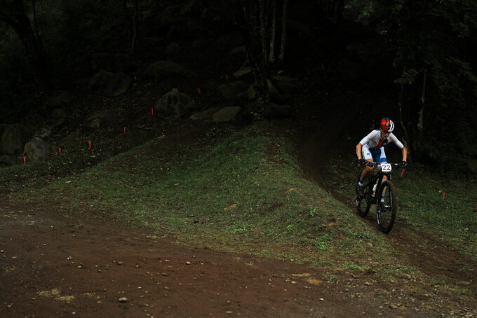 Jitka Cabelicka of the Czech Republic competes during the women's cross-country mountain bike competition at the 2020 Summer Olympics, Tuesday, July 27, 2021, in Izu, Japan. (AP Photo/Thibault Camus)