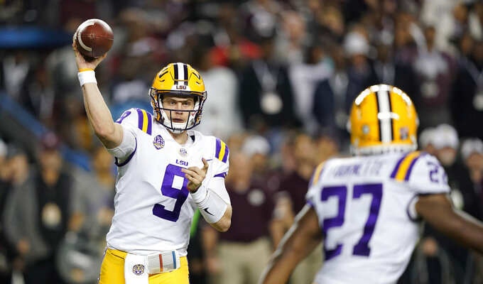LSU quarterback Joe Burrow (9) throws a pass to running back Lanard Fournette (27) during the first half of an NCAA college football game against Texas A&M Saturday, Nov. 24, 2018, in College Station, Texas. (AP Photo/David J. Phillip)