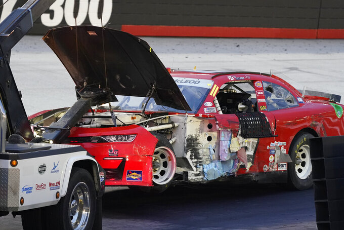 The car of B.J. McLeod (6) is towed into the garage after a wreck during the NASCAR Xfinity Series auto race Friday, Sept. 18, 2020, in Bristol, Tenn. (AP Photo/Steve Helber)