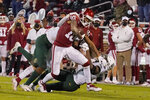 Oklahoma wide receiver Theo Wease (10) fights off Baylor defenders during the second half of an NCAA college football game Saturday, Dec. 5, 2020, in Norman, Okla. (AP Photo/Sue Ogrocki)