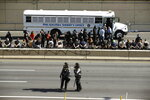 Police officers stand in Interstate 676 in Philadelphia, Monday, June 1, 2020, in the aftermath of protest and unrest in reaction to the death of George Floyd. Floyd died after being restrained by Minneapolis police officers on May 25. (AP Photo/Matt Rourke)
