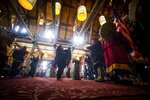 Members of the Nisqually Canoe Family perform during a grand opening event for the renovated Paradise Inn at Mount Rainier National Park in Paradise, Wash., on Friday, May 17, 2019. The Paradise Inn recently completed the second and final phase of a renovation project. (Joshua Bessex/The News Tribune via AP)
