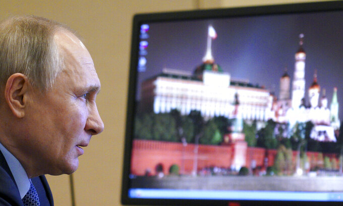 Russian President Vladimir Putin chairs a meeting with members of the Council for Interethnic Relations via video conference at the Novo-Ogaryovo residence outside Moscow, Russia, Tuesday, March 30, 2021. (Alexei Druzhinin, Sputnik, Kremlin Pool Photo via AP)