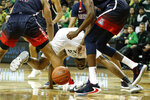 Oregon's Francis Okoro fights for a loose ball against Arizona during the first half of an NCAA college basketball game Thursday, Jan. 9, 2020, in Eugene, Ore. (AP Photo/Thomas Boyd)