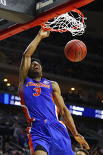 Florida guard Jalen Hudson dunks the ball during a first round men's college basketball game against Nevada in the NCAA Tournament, Thursday, March 21, 2019, in Des Moines, Iowa. (AP Photo/Charlie Neibergall)