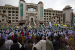 People wave Kashmiri flags to express solidarity with Indian Kashmiris during a rally at the Prime Minister office in Islamabad, Pakistan, Friday, Aug. 30, 2019. Khan said he had warned the international community that India could launch an attack on Pakistani-held Kashmir in an effort to divert the attention from human rights abuses in its portion of the disputed Himalayan region. (AP Photo/B.K. Bangash)