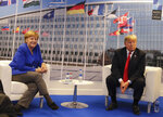 German Chancellor Angela Merkel, left, and U.S. President Donald Trump pose for a photograph prior to a bilateral meeting on the sideline of a summit of heads of state and government at NATO headquarters in Brussels Wednesday, July 11, 2018. NATO leaders gather in Brussels for a two-day summit to discuss Russia, Iraq and their mission in Afghanistan. (AP Photo/Markus Schreiber)