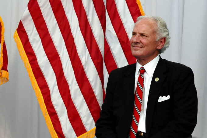 South Carolina Gov. Henry McMaster listens as Nephron Pharmaceuticals Corp. CEO Lou Kennedy speaks during the rollout of her new company, Nephron Nitrile, which Kennedy says will manufacture medical gloves as part of an effort to shore up the U.S. medical supply chain, Thursday, July 15, 2021, in West Columbia, S.C. (AP Photo/Meg Kinnard)
