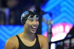 Torri Huske reacts after winning the Women's 100 Butterfly during wave 2 of the U.S. Olympic Swim Trials on Monday, June 14, 2021, in Omaha, Neb. (AP Photo/Charlie Neibergall)