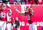 Indiana quarterback Peyton Ramsey (12) rushes back to the line-of-scrimmage after scoring a touchdown to run a two-point conversion play in the second half of an NCAA college football game against Iowa, Saturday, Oct. 13, 2018, in Bloomington, Ind. Iowa won 42-16. (AP Photo/Doug McSchooler)