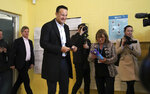 Fine Gael leader Leo Varadkar votes in the Irish General Election at Scoil Thomais in Castleknock, Dublin,  Saturday, Feb. 8, 2020.  Irish voters are choosing their next prime minister in an election where frustration with economic austerity and a housing crisis have fueled the rise of Sinn Fein, still shunned by the country's main political parties because of its links to the Irish Republican Army. (Damien Storan/PA via AP)