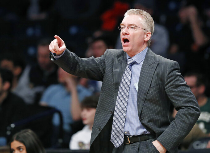 FILE - In this Sunday Feb. 4, 2018 file photo, Milwaukee Bucks interim head coach Joe Prunty yells at his players during the second half of an NBA basketball game against the Brooklyn Nets, Sunday, Feb. 4, 2018, in New York. Joe Prunty will coach USA Basketball in this weekend's AmeriCup qualifying games in San Juan. Joe Johnson is one of eight players on the team with NBA experience.. (AP Photo/Kathy Willens, File)