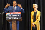 """Republican conservative radio talk show host Larry Elder with former actress and activist Rose McGowan hold a news conference at the Luxe Hotel Sunset Boulevard in Los Angeles Sunday, Sept. 12, 2021. Elder is running to replace Democratic Gov. Gavin Newsom in the Sept. 14 recall election. McGowan, who is known for her role in the """"Scream"""" movie franchise, was one of the earliest of dozens of women to accuse Hollywood producer Harvey Weinstein of sexual misconduct, making her a major figure in the #MeToo movement. (AP Photo/Damian Dovarganes)"""
