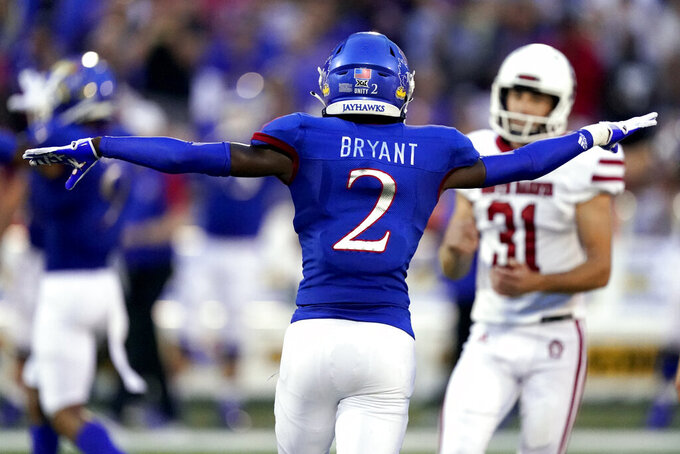 Kansas cornerback Jacobee Bryant (2) celebrates after South Dakota place kicker Mason Lorber (31) missed a field goal during the first half of an NCAA college football game Friday, Sept. 3, 2021, in Lawrence, Kan. (AP Photo/Charlie Riedel)