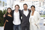 Mercedes Kilmer, from left, Jack Kilmer, director Leo Scott and director Ting Poo pose for photographers at a photo call for the film 'Val' during the 74th international film festival, Cannes, southern France, Wednesday, July 7, 2021. (Photo by Vianney Le Caer/Invision/AP)