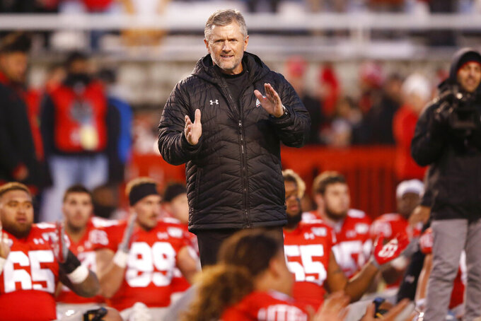 FILE - In this Nov. 30, 2019, file photo, Utah head coach Kyle Whittingham looks on before the start of their NCAA college football game against Colorado in Salt Lake City. The return of football isn't likely to make much of a dent in the losses athletic departments across the Pac-12 will ultimately incur because of the coronavirus pandemic. Faced with dramatic budget shortfalls, most schools in the league have already resorted to layoffs, furloughs, and cutting some sports entirely. At Utah, football coach Kyle Whittingham and men's basketball coach Larry Krystkowiak both took salary cuts to help offset up to $60 million in projected losses. (AP Photo/Rick Bowmer, File)