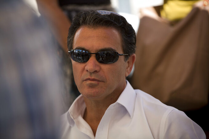 FILE - In this July 3, 2016, file photo, Yossi Cohen, then the director of Israel's Mossad intelligence agency, attends the funeral in Jerusalem of a rabbi killed by Palestinian gunmen. Cohen, the outgoing chief of Israel's Mossad intelligence service, offered the closest acknowledgment yet his country was behind a series of recent attacks targeting Iran's nuclear program and a military scientist in a television interview aired Thursday, June 10, 2021. (AP Photo/Oded Balilty, File)