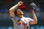 St. Louis Cardinals' pitcher Miles Mikolas takes a moment following a mound visit after Minnesota Twins' Max Kepler drove in a run in the first inning of a baseball game Wednesday, May 16, 2018, in Minneapolis. (AP Photo/Jim Mone)