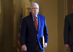 Senate Minority Leader Mitch McConnell, R-Ky., walks to the chamber as the Senate works to advance the $1 trillion bipartisan infrastructure bill, at the Capitol in Washington, Monday, Aug. 2, 2021. The 2,700-page bill includes new expenditures on roads, bridges, water pipes broadband and other projects, plus cyber security. (AP Photo/J. Scott Applewhite)