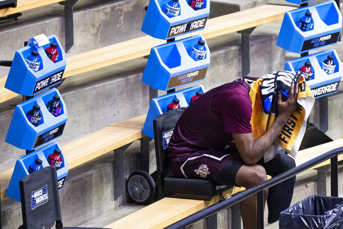 Texas Southern's Joirdon Karl Nicholas reacts on the bench in the final moments of Texas Southern's loss to Michigan in a first-round game in the NCAA men's college basketball tournament, Saturday, March 20, 2021, at Mackey Arena in West Lafayette, Ind. (AP Photo/Robert Franklin)