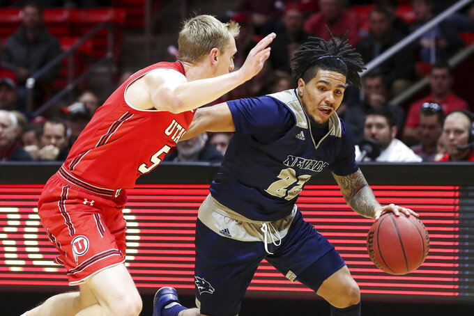 Nevada guard Jazz Johnson (22) dribbles the ball while being guarded by Utah guard Parker Van Dyke (5) during the first half of an NCAA college basketball game, Saturday, Dec. 29, 2018, in Salt Lake City. (AP Photo/Chris Nicoll)
