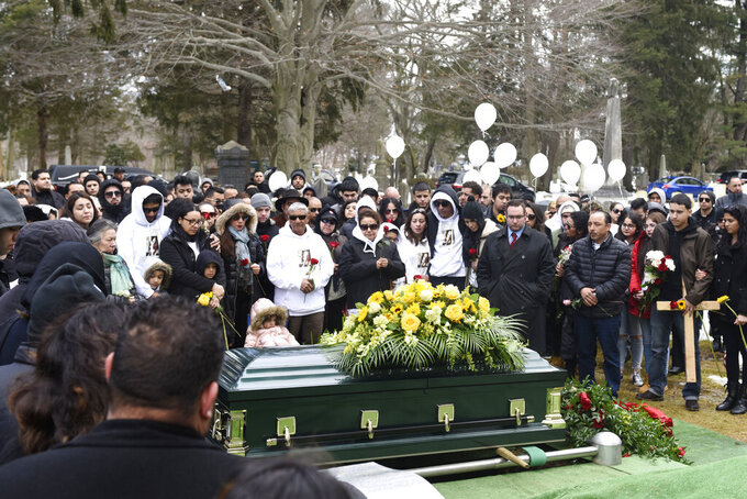 """FILE — In this Feb. 13, 2019 file photo, friends and family of homicide victim Valerie Reyes attend her burial at Greenwood Union Cemetery in Rye, N.Y. Javier Da Silva, who killed Valerie Reyes, whose body was found in a suitcase dumped in Connecticut, is """"incredibly remorseful"""" for what he did to her and the pain he inflected on her family, and he understands he must serve a long prison sentence, according to new court documents filed by his lawyers, Wednesday, Sept. 8, 2021. (Tyler Sizemore/Hearst Connecticut Media via AP, File)"""